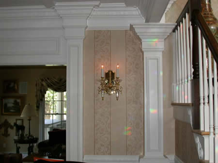 Artful moulding installation, patterned handdone wall finish