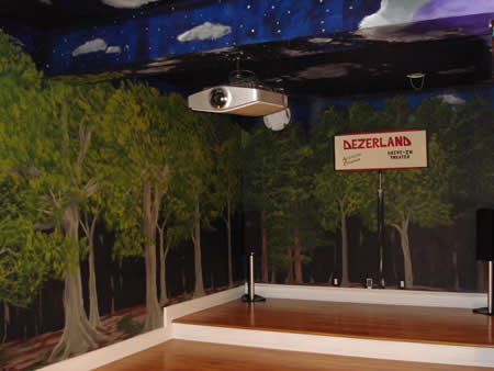 Night sky/ trees drive-in theatre themed screening room.