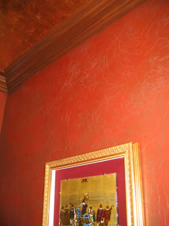 Textured wall finish, copper leaf ceiling, crown moulding.